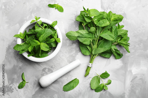 Fresh mint with mortar and pestle on grey marble table, flat lay Wallpaper Mural