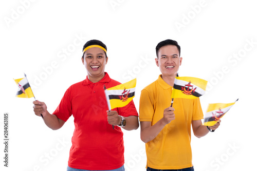 Photo Asian young man supporter of brunei national team
