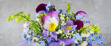 Pansy, forget-me-not, violet and lily of the valley flowers in one beautiful bouquet
