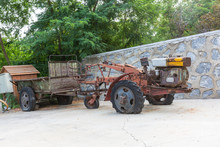 Outdoor Scrapped Rusty Chinese Style Walking Tractor Wreck