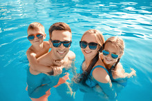 Happy Family In Swimming Pool ...