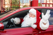 Santa Claus Leaning Out Of Car...