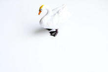 Figurine Of A Swan On A White ...