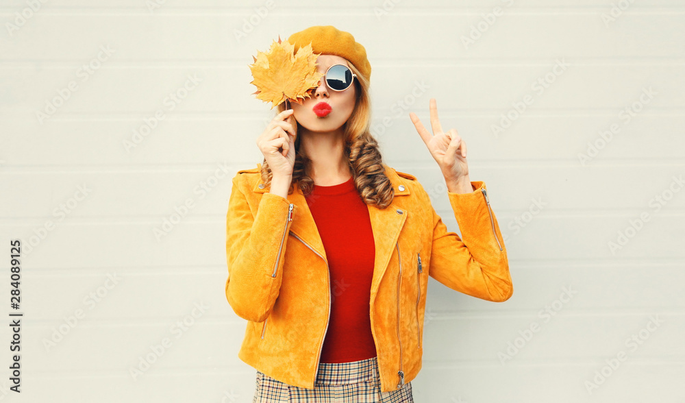 Fototapety, obrazy: Autumn mood! woman holding in her hands yellow maple leaves hiding her eyes over gray wall background