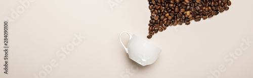 top view of coffee cup near grains on beige background, panoramic shot