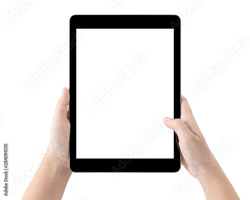 Obraz Hands holding tablet computer and blank white screen on table with clipping path. - fototapety do salonu