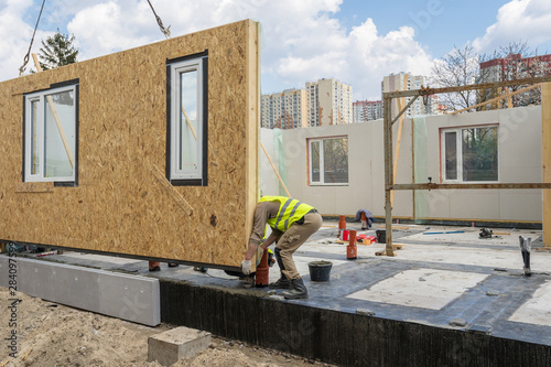 Canvas Print Construction of new and modern modular house