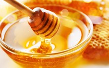 Honey With Spoon In Glass Bowl