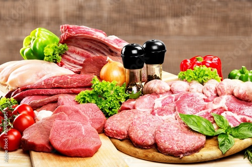 Fresh raw meat background with vegetables on wooden desk isolated on white background - 284104957