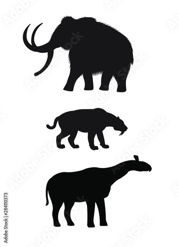 Photo  Vector set of black silhouette of prehistoric animals: mammoth, saber-toothed ti