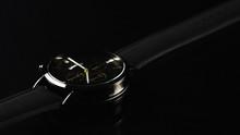 Close Up Of Wristwatch On Blac...