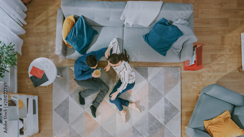 Happy Couple is Sitting on a Floor and Talking Canvas Print