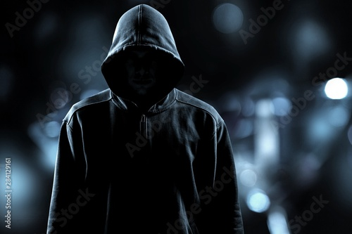 Pinturas sobre lienzo  Thief in black clothes on grey background