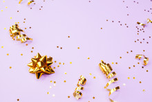 Golden Decorations And Sparkles On Pale Purple Background