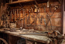 Complete Workbench With A Wall Of Tools In A Workshop. Vintage Look