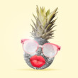 Leinwandbild Motiv Al alternative view of usual fruits. Pineapple as a disco ball in eyeglasses sending kisses on yellow background. Negative space. Modern design. Contemporary art collage. Concept of music.