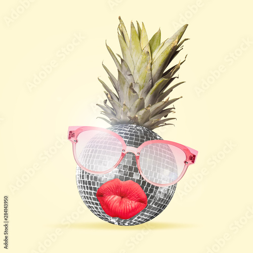 Leinwanddruck Bild - master1305 : Al alternative view of usual fruits. Pineapple as a disco ball in eyeglasses sending kisses on yellow background. Negative space. Modern design. Contemporary art collage. Concept of music.