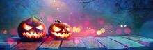 Jack O' Lanterns Glowing In Fantasy Night. Halloween Background