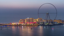 Bluewaters Island In Dubai Aerial Day To Night Timelapse After Sunset.