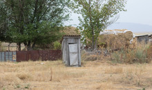 Old Wooden Rustic Toilet On The Plot