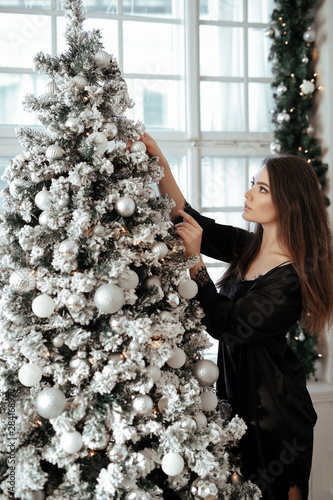 Woman by the Christmas tree
