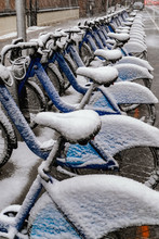 Bicycle Completely Covered With Snow Parked Near The Sea In Winter, New York City