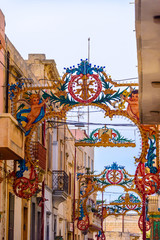 Colourful decorative arches are erected for the festival of Saint Peter and Saint Paul in Nadur, Gozo, Malta.