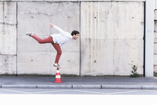 Young Man Balancing On Traffic...