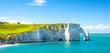Leinwandbild Motiv Picturesque panoramic landscape on the cliffs of Etretat. Natural amazing cliffs. Etretat, Normandy, France, La Manche or English Channel. Coast of the Pays de Caux area in sunny summer day. France