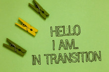 Word Writing Text Hello I Am.. In Transition. Business Concept For Changing Process Progressing Planning New Things Outline Words Green Middle Yellow Paper Clip On Olive Color Ground