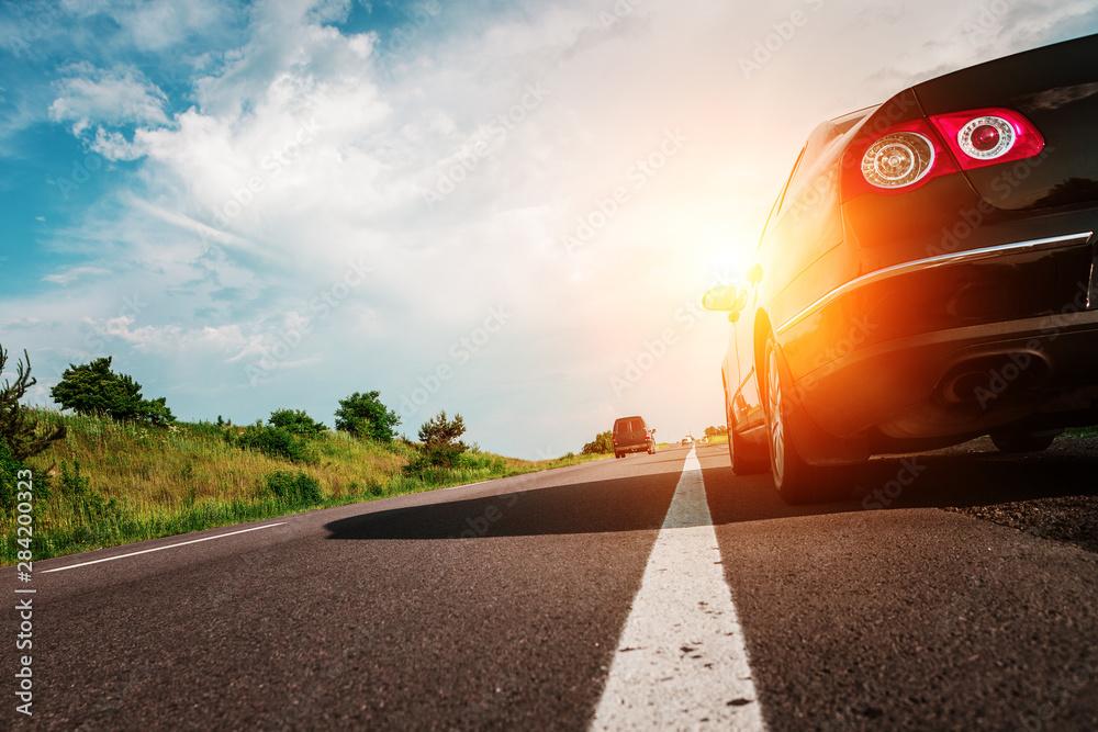 Fototapeta black car on asphalt road