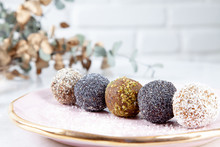 Close Up View On Different Set Of Raw, Healthy, No Sugar, Vegan Candy. Sweet Cakes For Dieting Menu. Gluten Free Sweets. Raw Candy Balls. Energy Ball Cakes On Pink Plate. Flat Lay