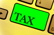 Leinwandbild Motiv Text sign showing Tax. Conceptual photo Compulsory payment of taxes by people to government increase revenue Close up Keyboard key yellow laptop notebook creative computer key shadow