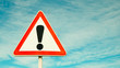 canvas print picture - Exclamation point of attention against the sky. triangular sign. Danger, warning.