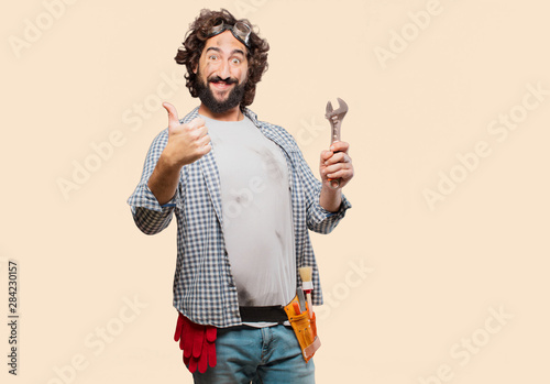 Fotomural  househusband handyman with a wrench