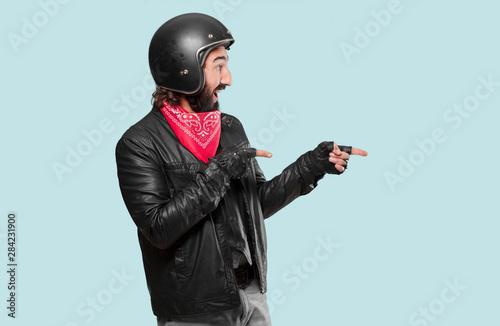 motorbike rider pointing sign Wallpaper Mural