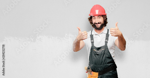 Fotografie, Obraz  young man worker proud an satisfied