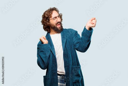 Obraz young man wearing bathrobe night suit dancing - fototapety do salonu