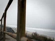 Beach Through Railings On A Mi...