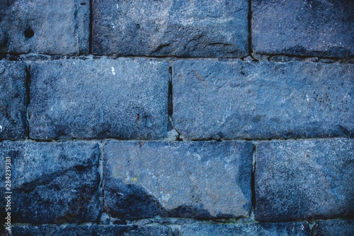 Old ashlar stone wall textures from an old local building. Wallpaper Mural