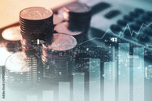 Fototapeta Double exposure of graph , stationary  and rows of coins for goal office ,  finance and business concept background obraz