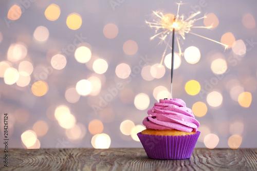 Tasty Birthday cupcake on table against defocused lights Canvas-taulu