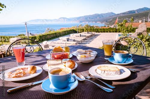 Photo  breakfast table with a view over the Orosei coast at Cala Gonone Sardinia Italy,