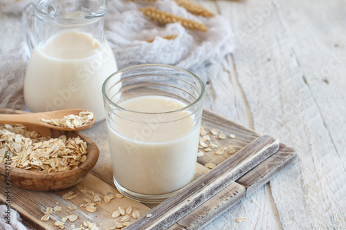 Fotografie, Obraz Vegan oat milk, non dairy alternative milk