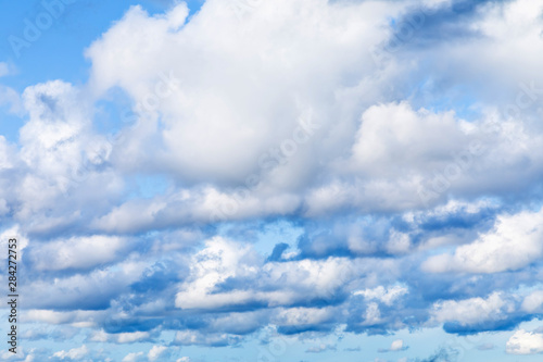 The vivid sky or heaven background with white and blue clouds under the sun rays Wallpaper Mural