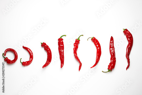Foto auf AluDibond Hot Chili Peppers whole ripe red hot chili peppers on a white background