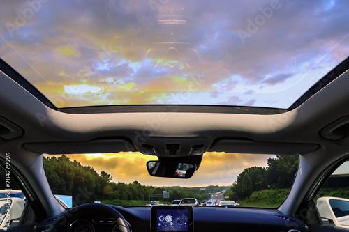 Fototapeta a car sunroof and sunset obraz