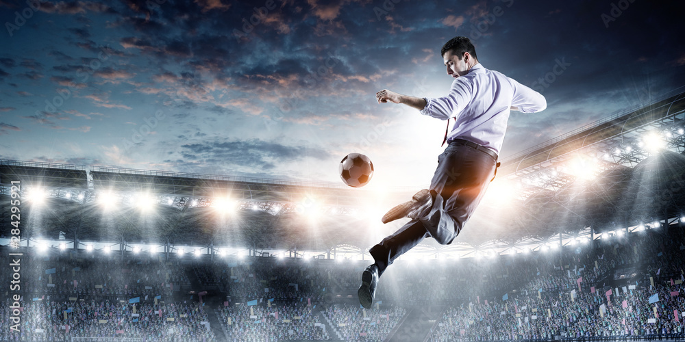 Fototapety, obrazy: Young businessman playing footbal in action