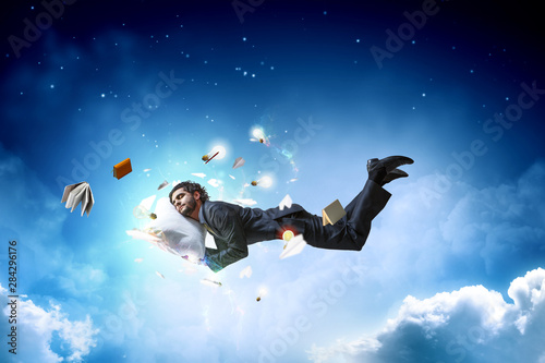 Fototapeta Joyful happe businessman levitating horizontally obraz