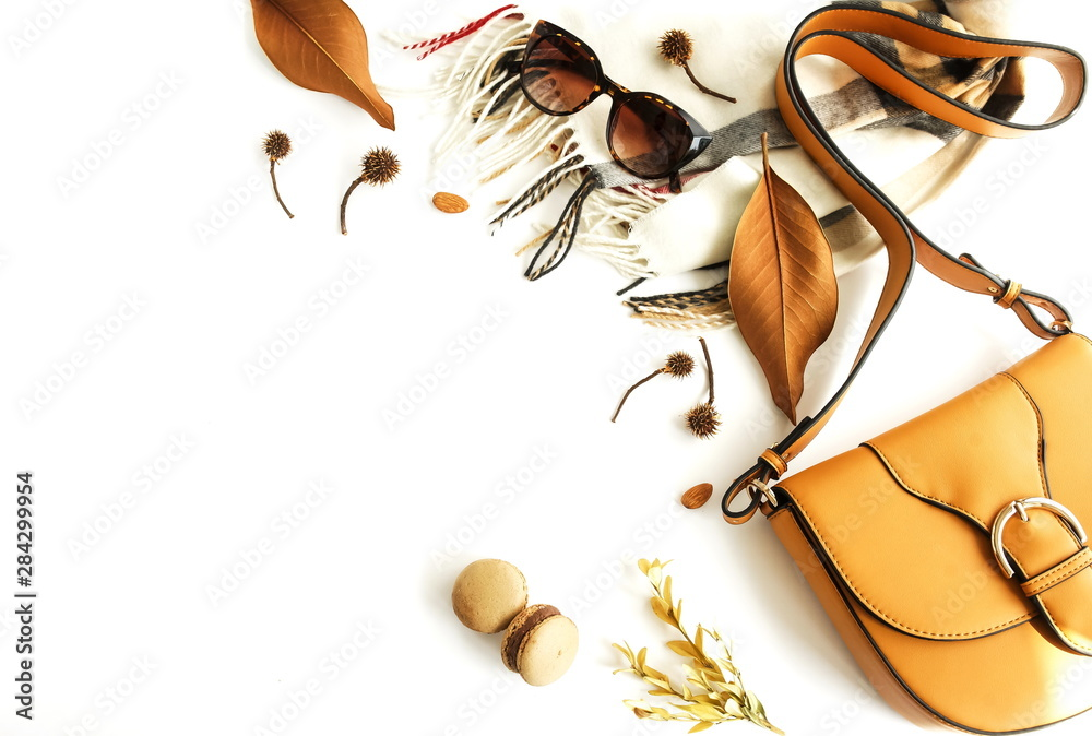 Fototapety, obrazy: Autumn composition with women fashion  accessories top view on white background toned. Flat lay collage of female style look with bag, sunglasses, scarf, notebook mock up, autumn leaves. Copy space